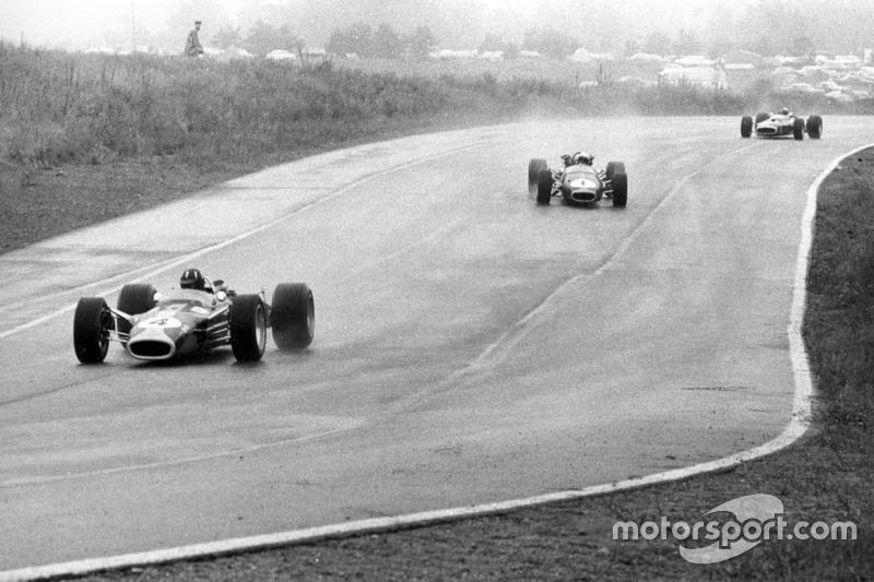 Graham Hill, Lotus 49-Ford; Jack Brabham, Brabham BT24-Repco; Jackie Stewart, BRM P83