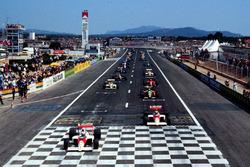 Alain Prost, McLaren MP4/5 Honda leads at the second start