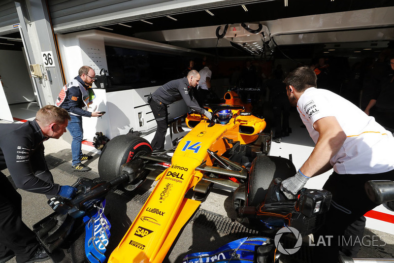 Fernando Alonso, McLaren MCL33, is returned to the garage