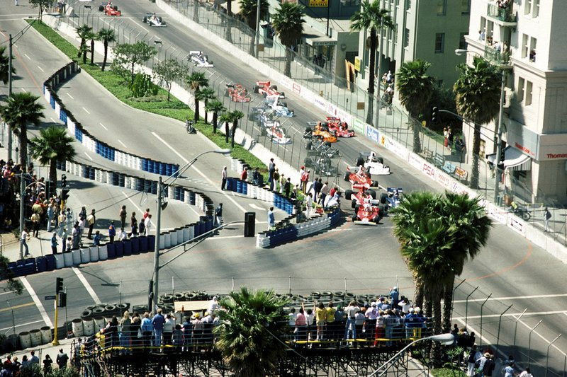 Clay Regazzoni, Ferrari 312T leads Patrick Depailler, Tyrrell 007 into the first corner at the start of the 1976 GP of Long Beach.