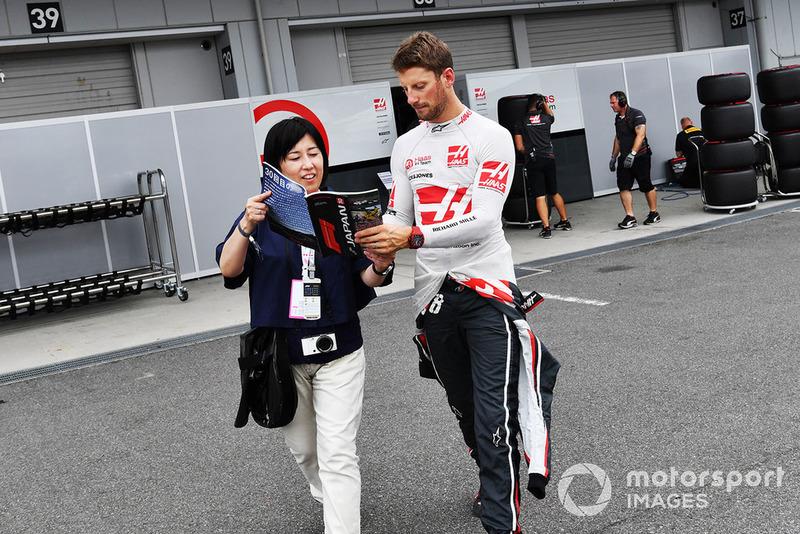 Romain Grosjean, Haas F1 Team signs an autograph for a fan