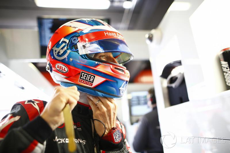 Romain Grosjean, Haas F1 Team, adjusts his helmet