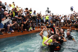 Daniel Ricciardo, Red Bull Racing, celebrates victory in the swimming pool on the Red Bull Energy Station with team members, designer Rob Marshall, Chief Engineering Officer, Red Bull Racing