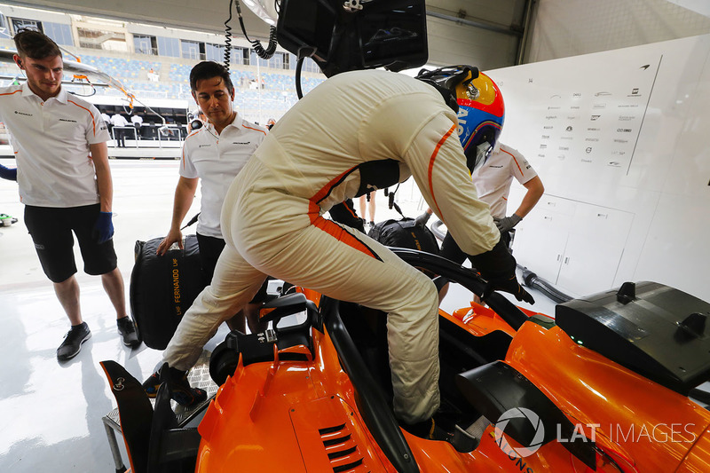 Fernando Alonso, McLaren, climbs in to his car