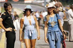 Lotus team manager Peter Warr watches after Nina Rindt and her friend on a walk in the pitlane