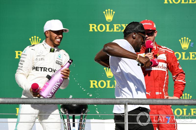 Podio: ganador de la carrera Lewis Hamilton, Mercedes AMG F1 y Usain Bolt, tercer lugar Kimi Raikkonen, Ferrari