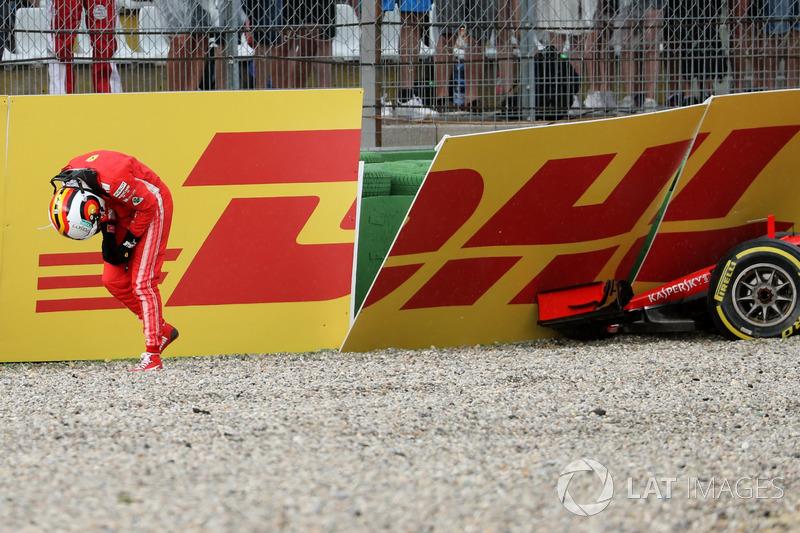 Sebastian Vettel, Ferrari SF71H walks in after crashing out of the race