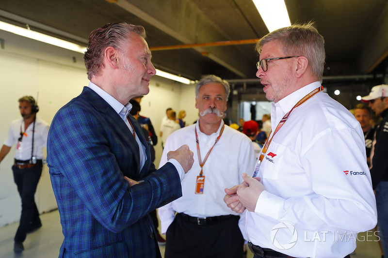 Sean Bratches, Managing Director of Commercial Operations, Formula One Group, Chase Carey, Chairman, Formula One, and Ross Brawn, Managing Director of Motorsports, FOM