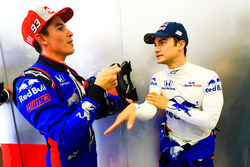 Marc Marquez tests the Toro Rosso F1 car, with Dani Pedrosa listening