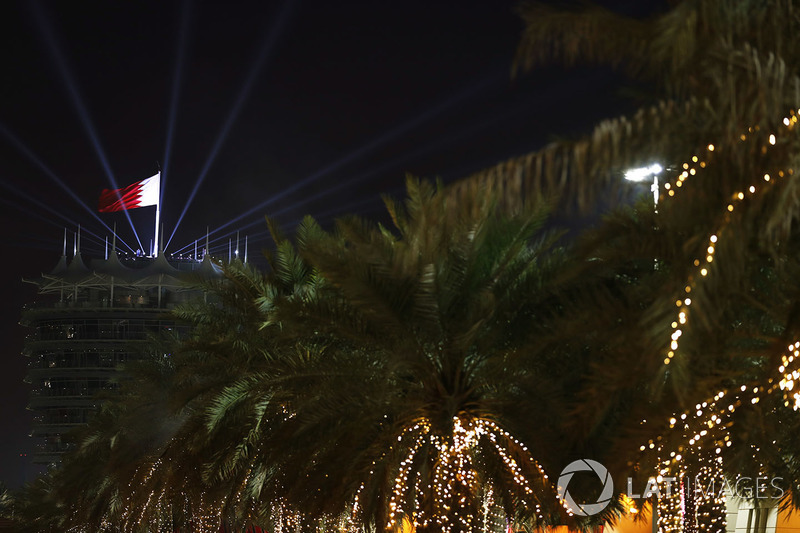 A Bahrain flag flies with lighting effects above the circuit tower