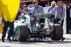 Lewis Hamilton, Mercedes AMG F1 W07 Hybrid is pushed back in the pits after stopping in the pit lane