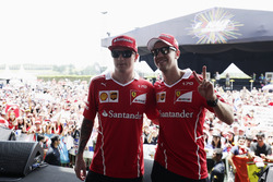 Kimi Raikkonen, Ferrari, Sebastian Vettel, Ferrari, pose on stage at a fan event