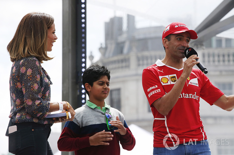 Marc Gene, Ferrari, speaks from the stage alongside Natalie Pinkham, TV Presenter, Sky Sports F1