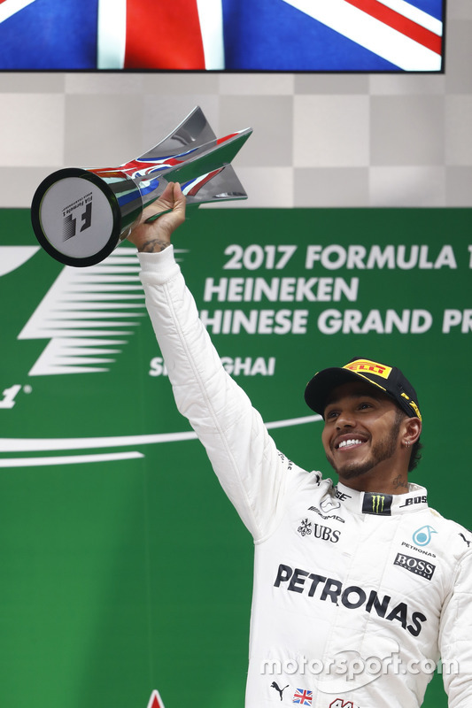 Lewis Hamilton, Mercedes AMG, celebrates with his trophy on the podium