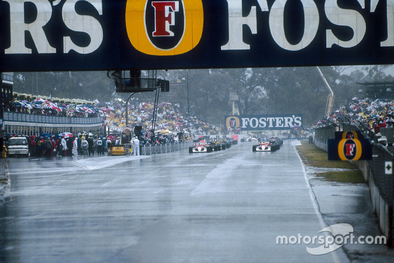 The grid lines up ready for the start in the very wet conditions