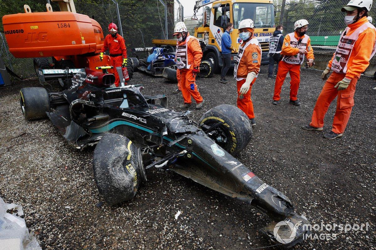 Marshals clear the damaged car of Valtteri Bottas