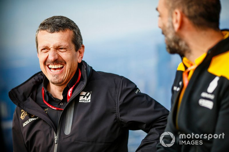 Guenther Steiner, Team Principal, Haas F1, with Cyril Abiteboul, Managing Director, Renault F1 Team