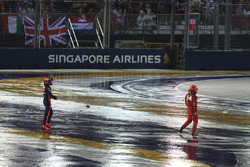 Kimi Raikkonen, Ferrari and Max Verstappen, Red Bull Racing walk in after crashing at race start