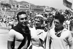 Second place Eugenio Castellotti, Lancia D50, third place Cesare Perdisa, Maserati 250F, pose with a local beauty and Harry Schell, Ferrari 555 Supersqualo stands behind