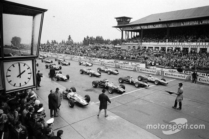 Polesetter Jim Clark, Lotus, John Surtees, Cooper, Jackie Stewart, BRM, and Ludovico Scarfiotti, Ferrari on the front row