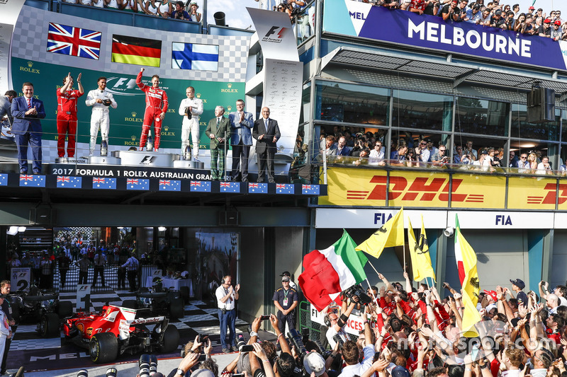 Luigi Fraboni, Head of Power Unit Race Operation, Ferrari, Lewis Hamilton, Mercedes AMG, 2nd Position, Sebastian Vettel, Ferrari, 1st Position, and Valtteri Bottas, Mercedes AMG, 3rd Position, on the podium