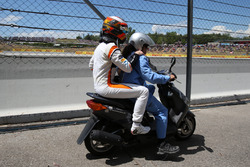 Race retiree Stoffel Vandoorne, McLaren on a scooter