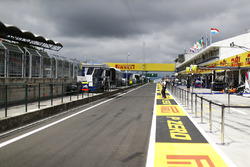 A view down the pit lane, including prominent Pirelli branding