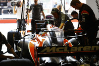 Fernando Alonso, McLaren, prepares to leave his pit garage