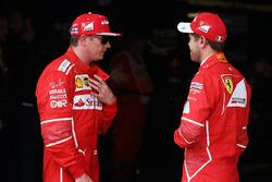 Kimi Raikkonen, Ferrari, with Sebastian Vettel, Ferrari