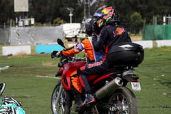 Race retiree Brendon Hartley, Scuderia Toro Rosso gets a ride with a Marshal on a motorbike after re