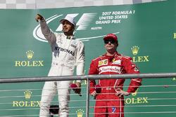 Race winner Lewis Hamilton, Mercedes AMG F1 and third place Kimi Raikkonen, Ferrari celebrate on the podium