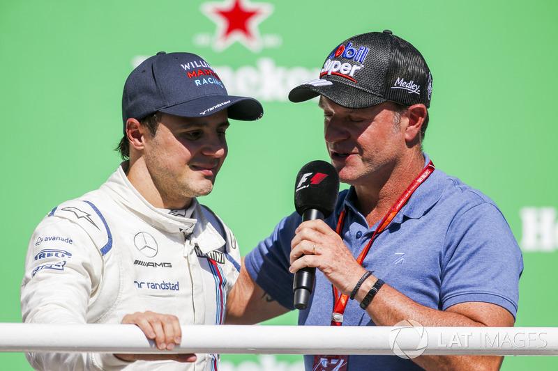 Rubens Barrichello interviews Felipe Massa, Williams, on the podium