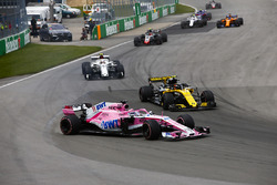 A sideways Sergio Perez, Force India VJM11, battles with Carlos Sainz Jr., Renault Sport F1 Team R.S. 18