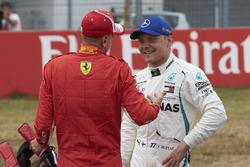 Polesitter Sebastian Vettel, Ferrari, en Valtteri Bottas, Mercedes AMG F1