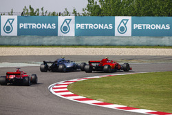 Valtteri Bottas, Mercedes AMG F1 W09, passes Kimi Raikkonen, Ferrari SF71H, for the lead of the race, as Sebastian Vettel, Ferrari SF71H follows