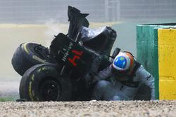 Fernando Alonso, McLaren MP4-31 exits his car after a huge crash