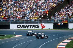 Mika Hakkinen, McLaren Mercedes MP4/13 leads team mate David Coulthard McLaren Mercedes MP4/13