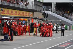 Ferrari mechanics await a pit stop