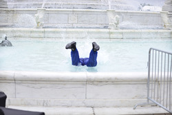 Gar Robinson celebrates his 2nd place finish by jumping into the James Scott Memorial Fountain on Belle Isle