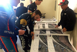 Drivers sign Justin Wilson poster