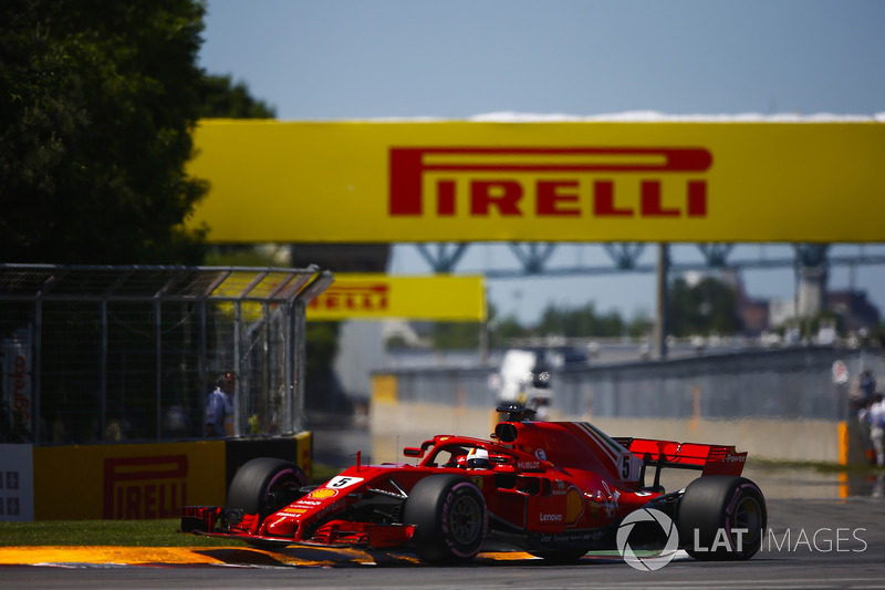 Sebastian Vettel, Ferrari SF71H, bounces over a kerb