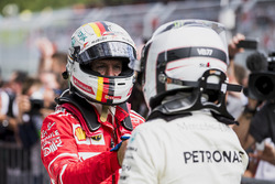 Second place Sebastian Vettel, Ferrari, congratulates Race winner Valtteri Bottas, Mercedes AMG F1, in Parc Ferme