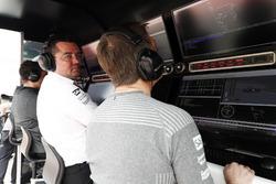 Eric Boullier, Racing Director, McLaren, and Stoffel Vandoorne, McLaren, on the pit wall