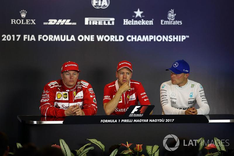 Прес-конференція після гонки: переможець гонки Себастьян Феттель, Ferrari, друге місце Кімі Райкконен, Ferrari, третє місце Валттері Боттас, Mercedes AMG F1