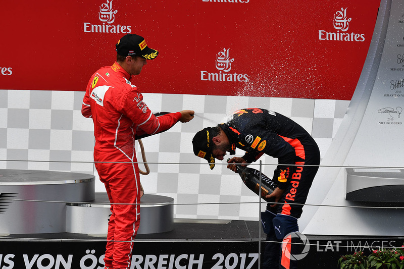 Sebastian Vettel, Ferrari, Daniel Ricciardo, Red Bull Racing celebrate on the podium