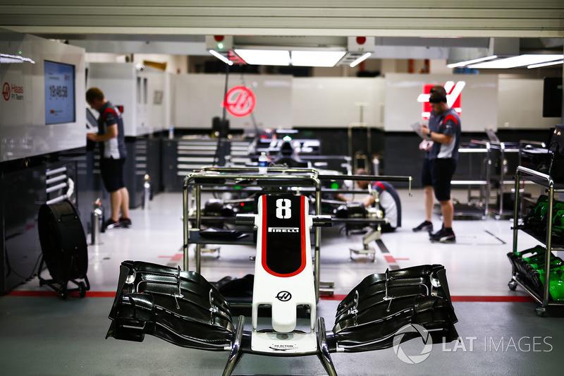 The car of Romain Grosjean, Haas F1 Team VF-17, being prepared in the garage