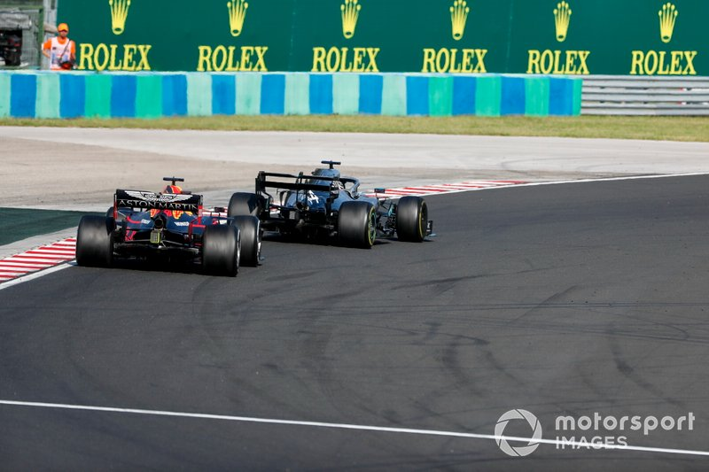 Lewis Hamilton, Mercedes AMG F1 W10 overtakes Max Verstappen, Red Bull Racing RB15 for the lead