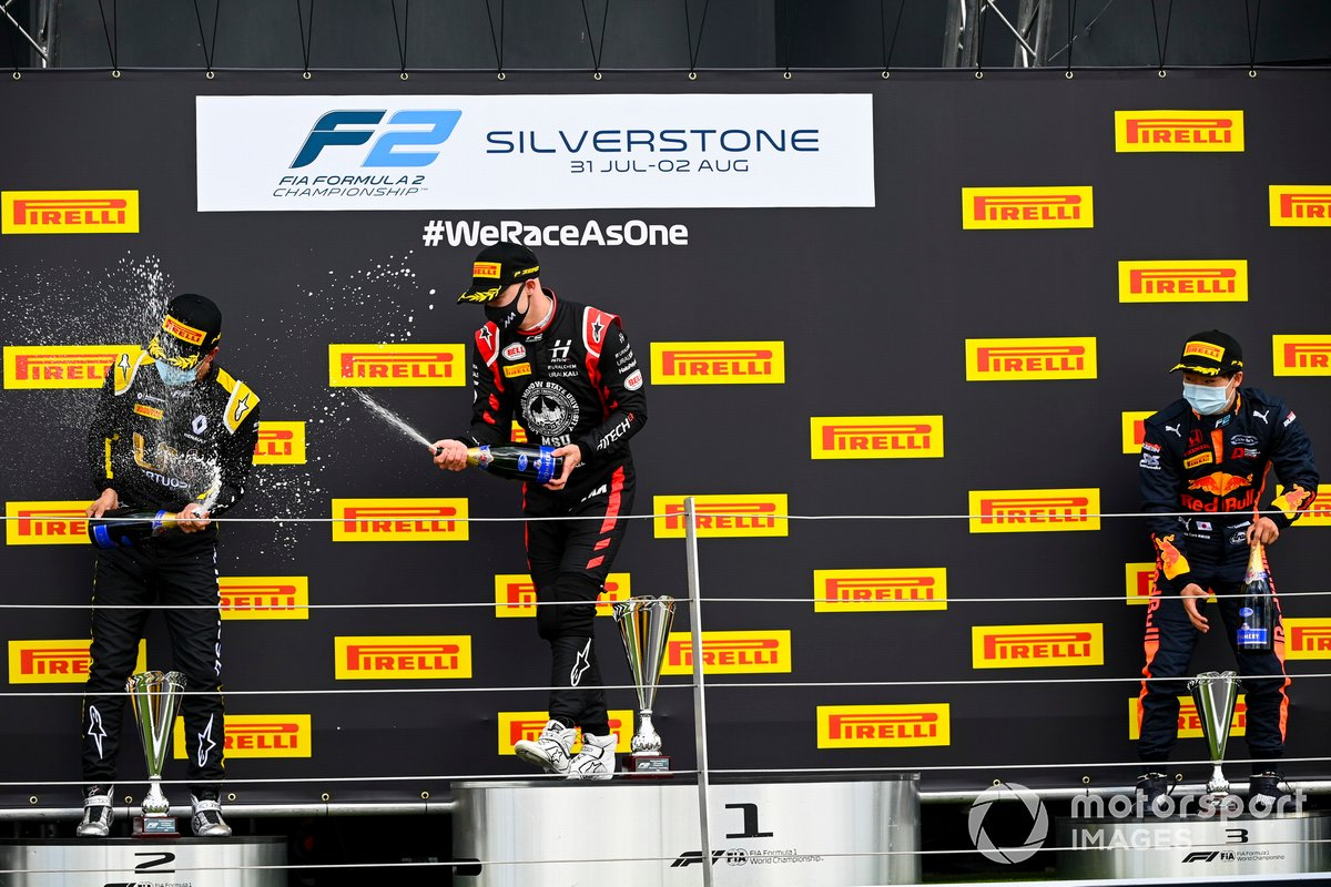 Guanyu Zhou, UNI-Virtuosi, 2nd position, Nikita Mazepin, Hitech Grand Prix, 1st position, and Yuki Tsunoda, Carlin, 3rd position, celebrate with Champagne on the podium