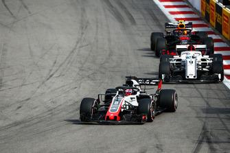 Romain Grosjean, Haas F1 Team VF-18, leads Marcus Ericsson, Sauber C37, and Max Verstappen, Red Bull Racing RB14