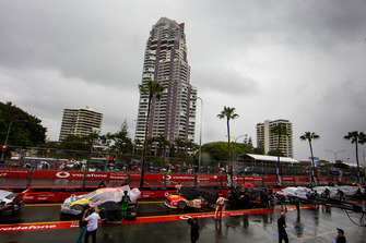 Cars lineup under cover in the pitlane